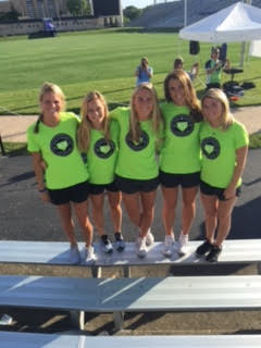 Ladies from the University of Michigan Lacrosse team volunteers to assist with the 2016 Cycle for a Cure Ride!